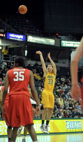 Rob Poole of Siena puts up a three-point-shot during their game against Fairfield at the Times Union Center on Sunday, Jan. 11, 2015, in Albany, N.Y.   (Paul Buckowski / Times Union) Photo: Paul Buckowski / 00030029C