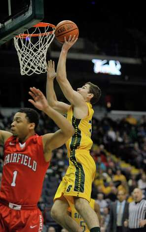 Rob Poole of Siena puts drives to the basket during their game against Fairfield at the Times Union Center on Sunday, Jan. 11, 2015, in Albany, N.Y.   (Paul Buckowski / Times Union) Photo: Paul Buckowski / 00030029C