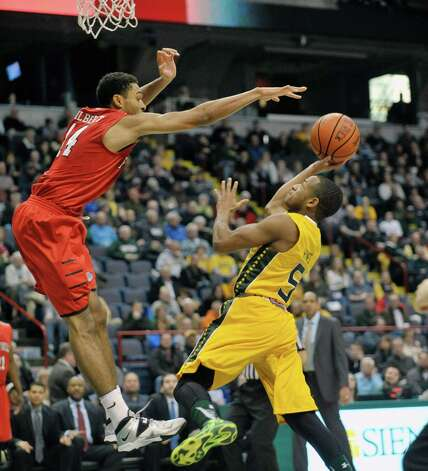 Evan Hymes of Siena, right, puts up a shot as he drives to the basket during their game against Fairfield at the Times Union Center on Sunday, Jan. 11, 2015, in Albany, N.Y.   (Paul Buckowski / Times Union) Photo: Paul Buckowski / 00030029C