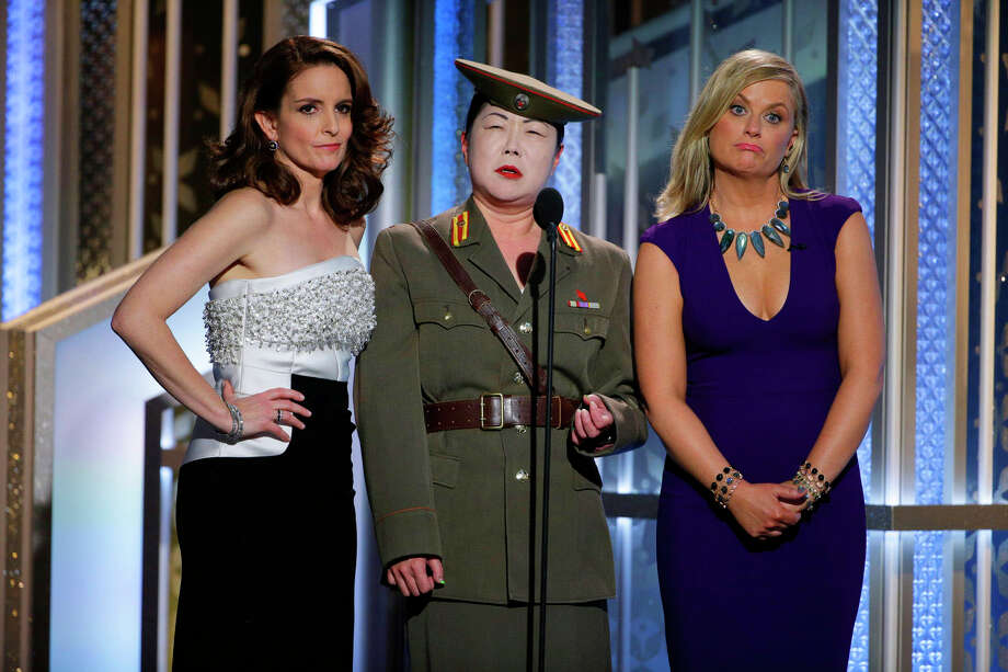 In this image released by NBC, Tiny Fey, from left, Margaret Cho, and Amy Poehler speak at the 72nd Annual Golden Globe Awards on Sunday, Jan. 11, 2015, at the Beverly Hilton Hotel in Beverly Hills, Calif. (AP Photo/NBC, Paul Drinkwater) Photo: Paul Drinkwater / Associated Press / NBC