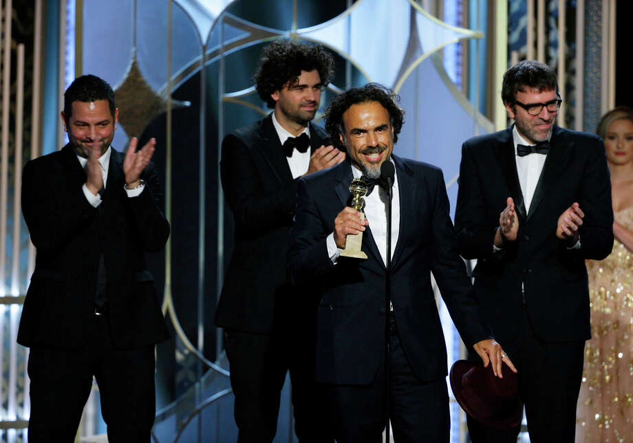 "In this image released by NBC,  Alejandro Gonzalez Inarritu, accepts the award  for best screenplay for ""Birdman,""with Alexander Dinelaris, background from left, Armando Bo, and Nicolas Giacobone at the 72nd Annual Golden Globe Awards on Sunday, Jan. 11, 2015, at the Beverly Hilton Hotel in Beverly Hills, Calif. (AP Photo/NBC, Paul Drinkwater) Photo: Paul Drinkwater / Associated Press / NBC"