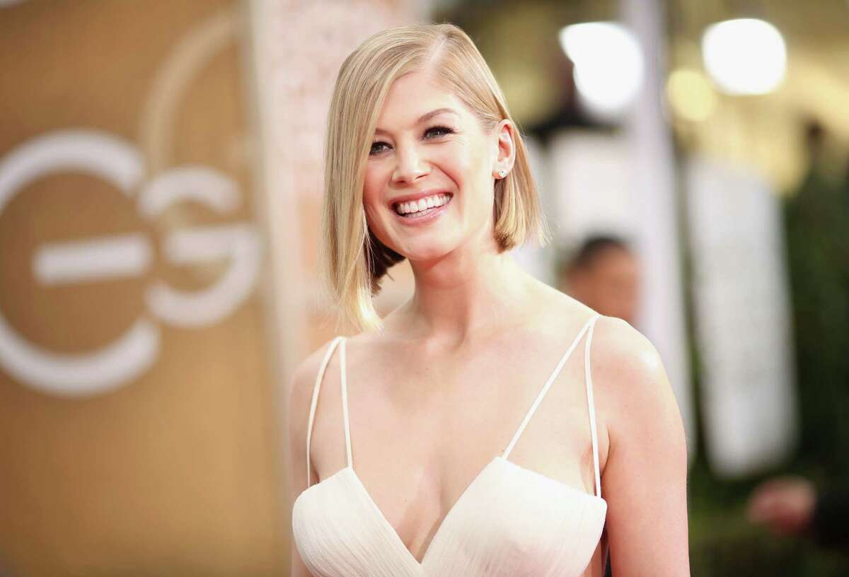 Actress Rosamund Pike arrives to the 72nd Annual Golden Globe Awards held at the Beverly Hilton Hotel on January 11, 2015.