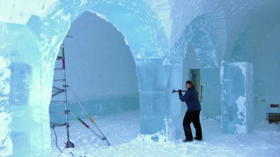 Artist Mary Gibbons works to shape an ice column in the ICEHOTEL. Photo: Contributed Photo / Greenwich Time Contributed