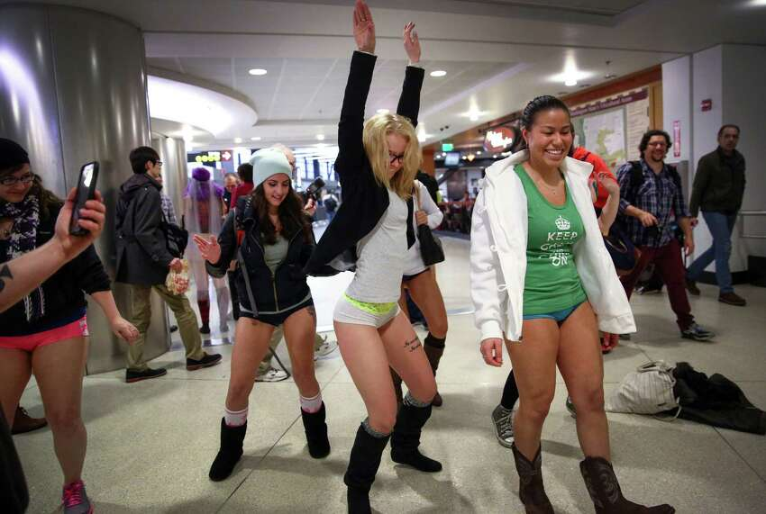 Participants have a no pants dance off at SeattleÐTacoma International Airport during Seattle's 6th annual No Pants Light Rail Ride. During the quirky annual event, participants strip down to their underwear and ride the rail as if nothing is unusual. They also make stops along the route, often surprising people. Photographed on Sunday, January 11, 2015 in Seattle.