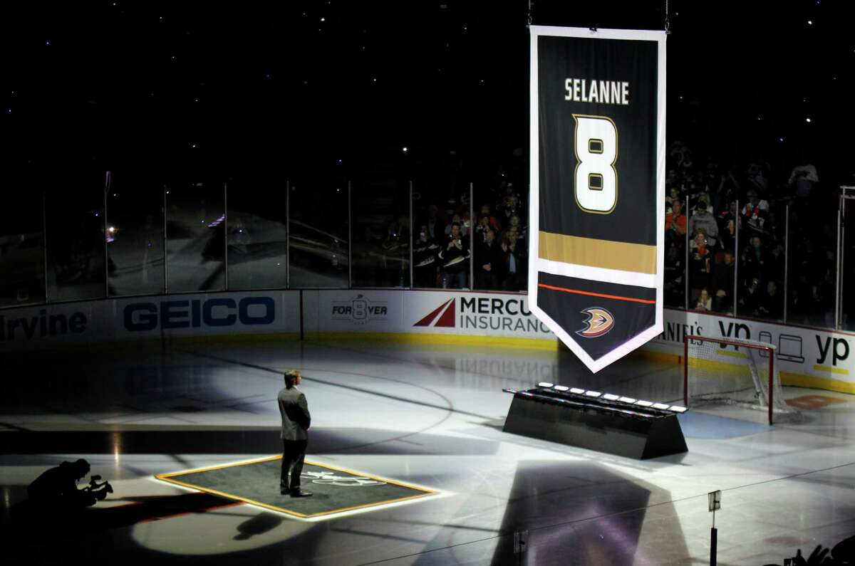 Former Anaheim Ducks player Teemu Selanne watches as the team retires his number with a banner, as it is raised before an NHL hockey game against the Winnipeg Jets in Anaheim, Calif., Sunday, Jan. 11, 2015. (AP Photo/Alex Gallardo) ORG XMIT: ANA101
