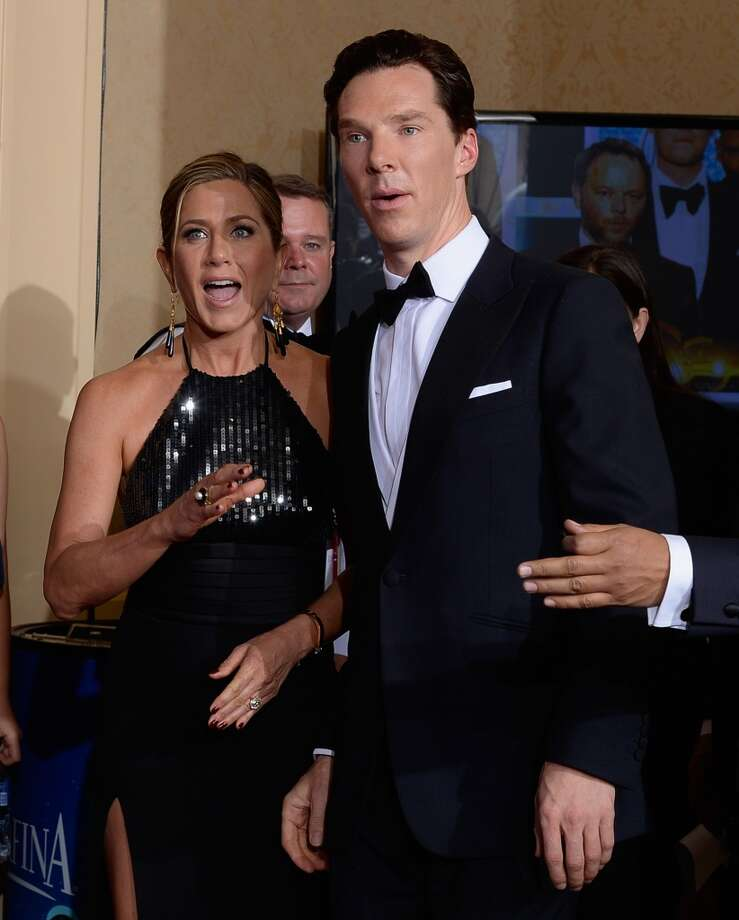 Actors Benedict Cumberbatch and Jennifer Aniston in pose in the press room at the 72nd Annual Golden Globe Awards held at the Beverly Hilton Hotel on January 11, 2015. Photo: Kevork Djansezian/NBC, NBC Via Getty Images