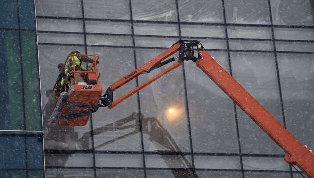 A little snow doesn't keep workers from getting things done at SUNY Poly's new building on Monday, Jan. 12, 2015. (Skip Dickstein/Times Union)