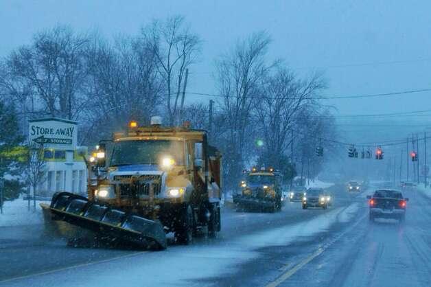 Plows clear Routes 9 & 20 in East Greenbush on Monday, Jan. 12, 2015. (Paul Buckowski/Times Union)