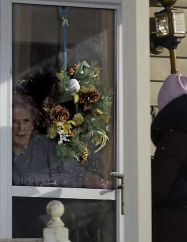 Patricia House comes to the door of her Willey Street home Wednesday morning, Jan. 7, 2015, in Guilderland, N.Y.  (Skip Dickstein/Times Union) Photo: ALBANY TIMES UNION