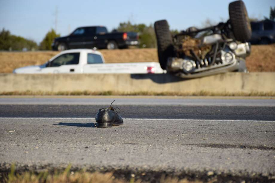 A jeep rolled over on Loop 1604 causing traffic to come to a standstill Monday, Jan. 12, 2015 Photo: By Mark D. Wilson/San Antonio Express-News