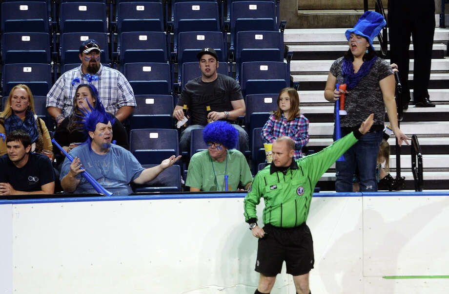 Oxford City FC fans motion at the referees after a call Saturday night. The Oxford City Football Club hosted the Dallas Sidekicks at Ford Arena on Saturday evening.  Photo taken Saturday 12/27/14  Jake Daniels/The Enterprise Photo: Jake Daniels / ©2014 The Beaumont Enterprise/Jake Daniels