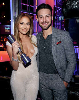 Jennifer Lopez and Ryan Guzman accept an award together. Photo: Chris Polk/PMA2014, File Photo / 2014 Chris Polk/PMA2014