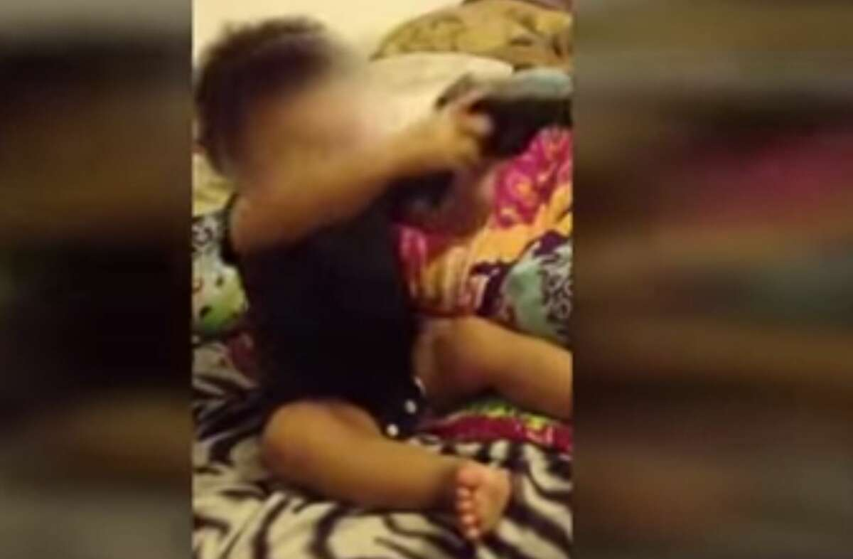 An Indiana couple faces charges after investigators say they found cellphone videos showing the woman's 12-month-old daughter putting a handgun in her mouth.
