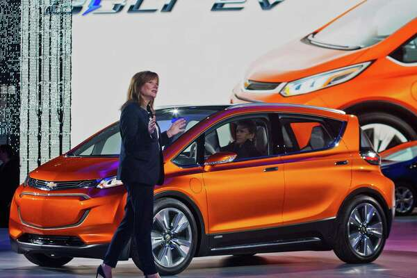 General Motors CEO Mary Barra presents the Bolt EV electric concept vehicle at the North American International Auto Show, Monday, Jan. 12, 2015, in Detroit.