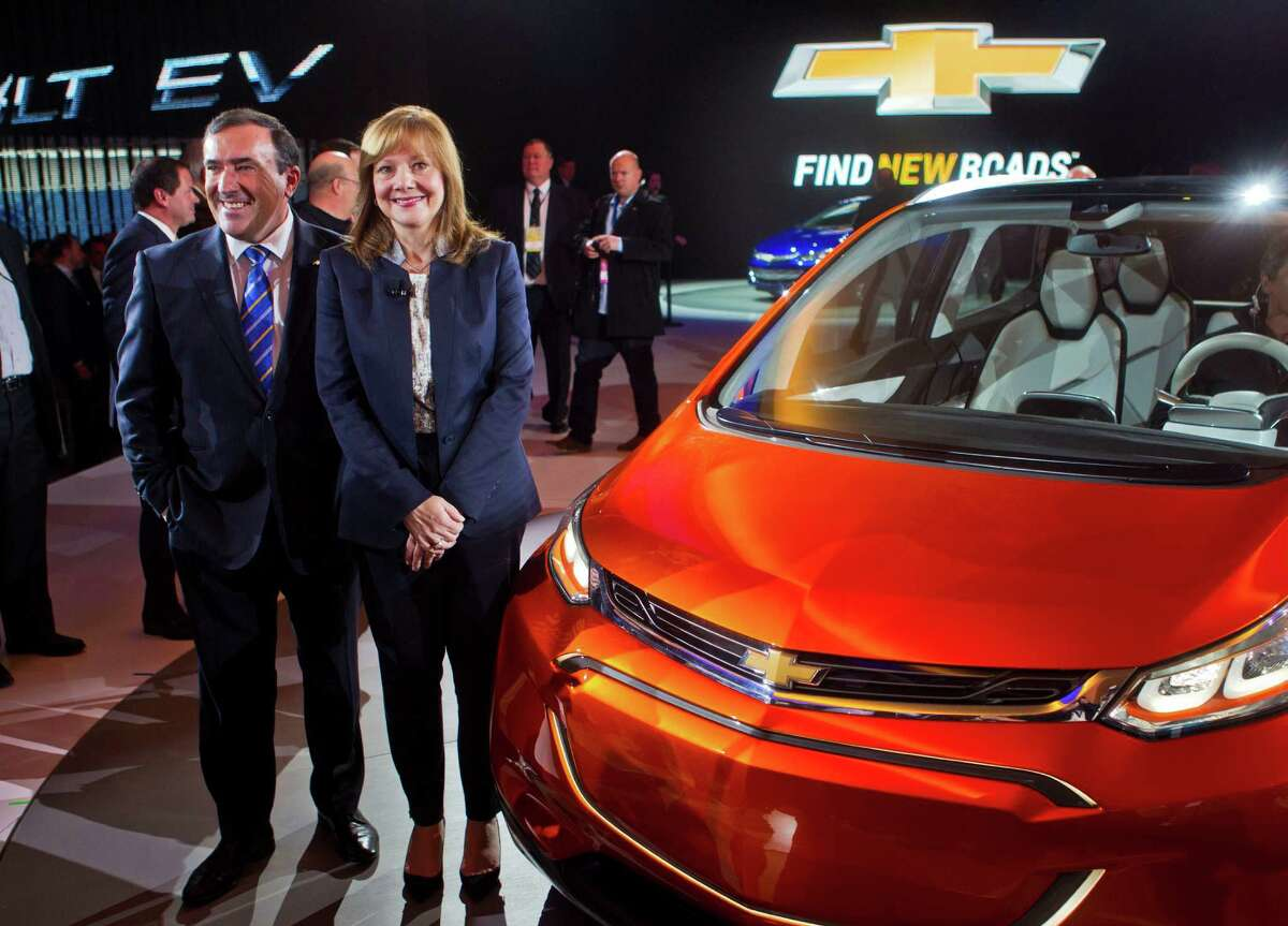 General Motors North America President Alan Batey, left, stands next to CEO Mary Barra, with the Bolt EV electric concept vehicle, at the North American International Auto Show, Monday, Jan. 12, 2015, in Detroit.