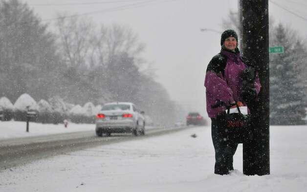 Gloria Jean Knorr of Colonie waits in the falling snow for the CDTA bus near her home on Monday, Jan. 12, 2015, in Colonie, N.Y.  (Paul Buckowski / Times Union) Photo: Paul Buckowski / 00030160A