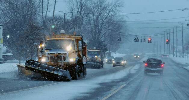 Snowplow operators clear the roads at Routes 9 and 20 on Monday morning, Jan. 12, 2015, in East Greenbush, N.Y.  (Paul Buckowski / Times Union) Photo: Paul Buckowski / 00030160A