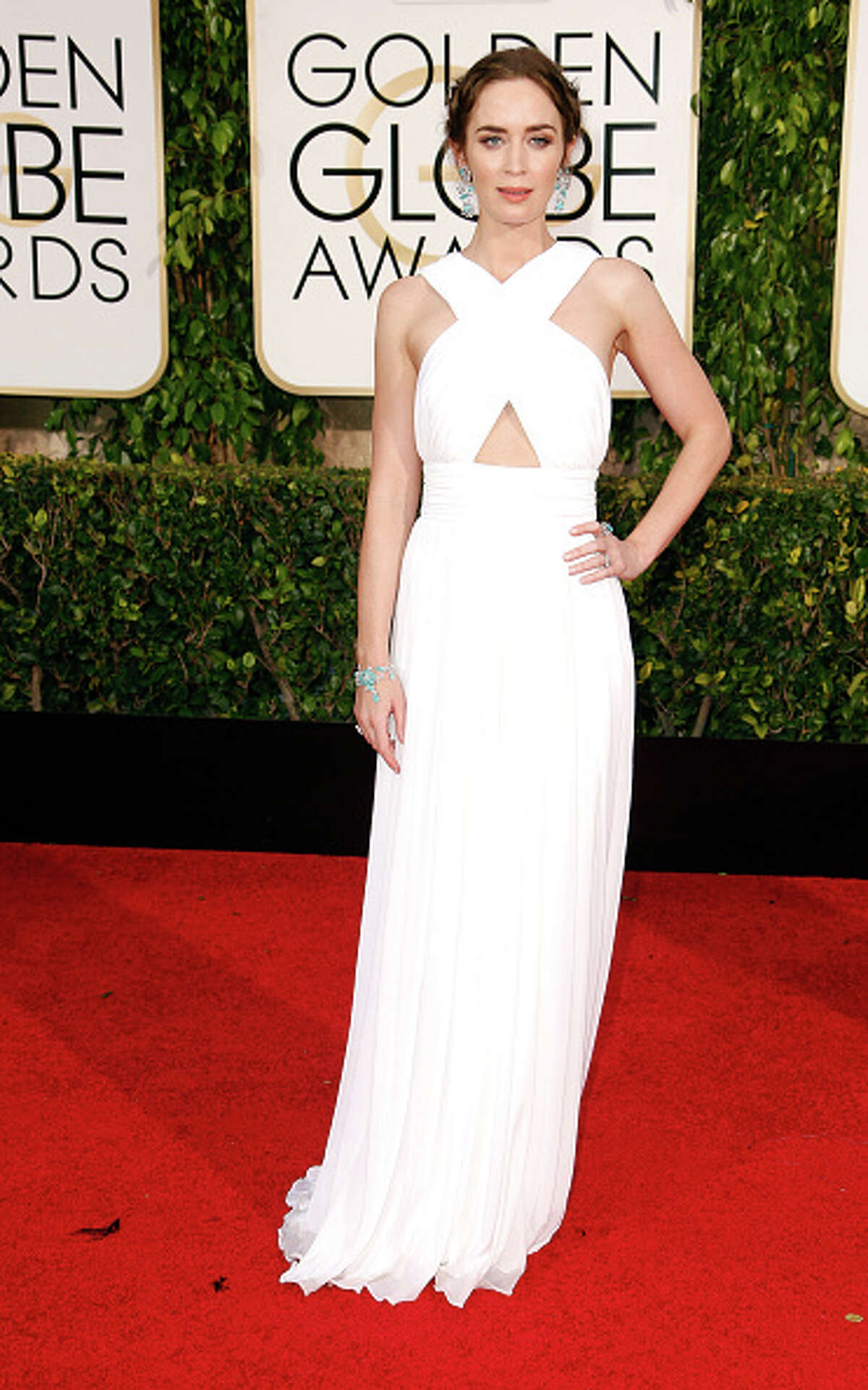 9. Emily Pictured: Emily Blunt in Michael Kors shows, again, how to master the classic white cutaway, this time with a slightly Grecian-inspired accent.