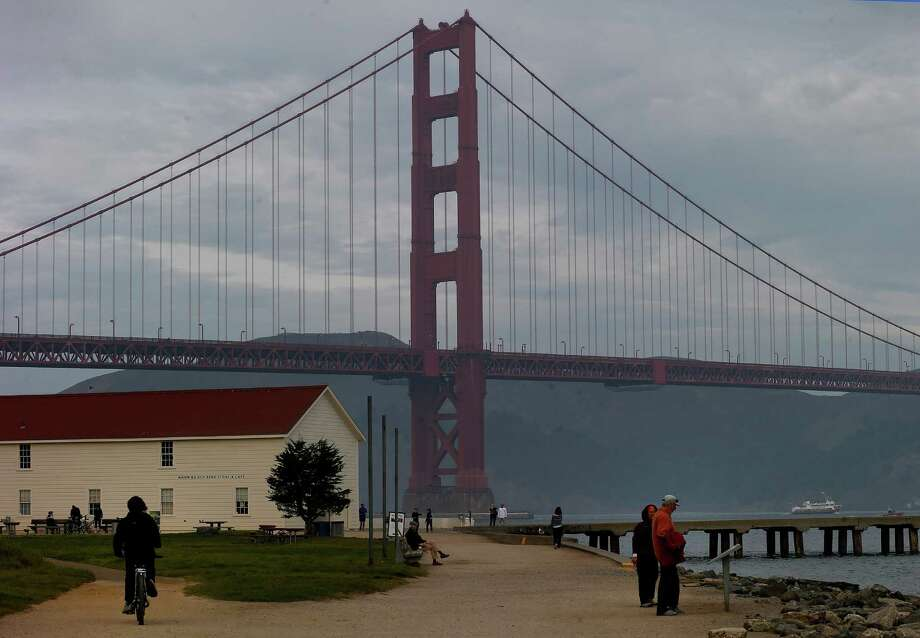 A former Army airfield, Crissy Field now boasts the Warming Hut, above left, as well as spectacular views of the Golden Gate Bridge and well-worn paths for exploring. Photo: Brant Ward / The Chronicle / ONLINE_YES