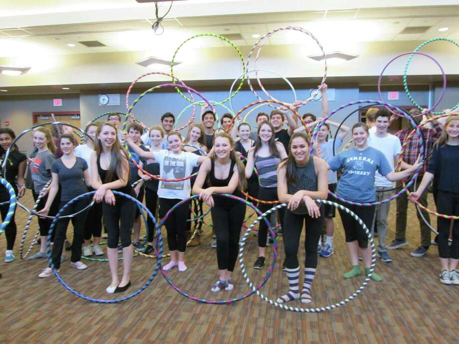 "Theatre students at New Canaan High School have been busy learning the finer points of hula hooping as they prepare for a scene in the school's upcoming production of ""Grease."" This upbeat musical about high school life in the 1950s features rock and roll music and dancing.The show runs March 19, 20, and 21 at 7:30 p.m. in the school's auditorium. Tickets are available at newcanaanhighschooltheatre.com. Photo: Contributed Photo / Greenwich Time Contributed"