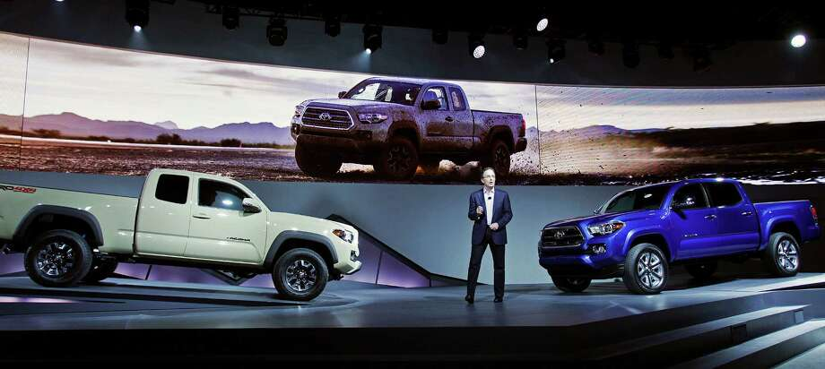 Bill Fay, group vice president and general manager of the Toyota division, unveils the Tacoma midsize pickup truck Monday at the 2015 North American International Auto Show in Detroit, Michigan. Photo: Bill Pugliano /Getty Images / 2015 Getty Images
