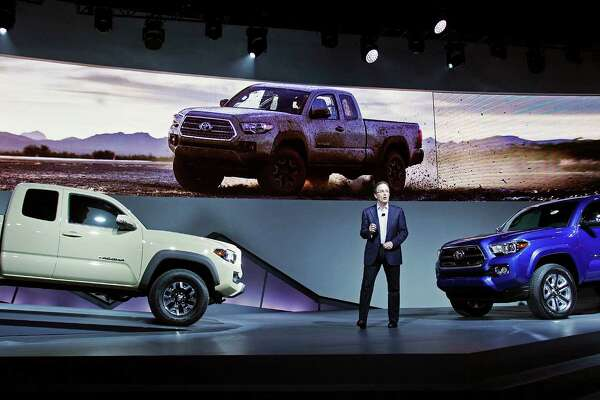 Bill Fay, group vice president and general manager of the Toyota division, unveils the Tacoma midsize pickup truck Monday at the 2015 North American International Auto Show in Detroit, Michigan.