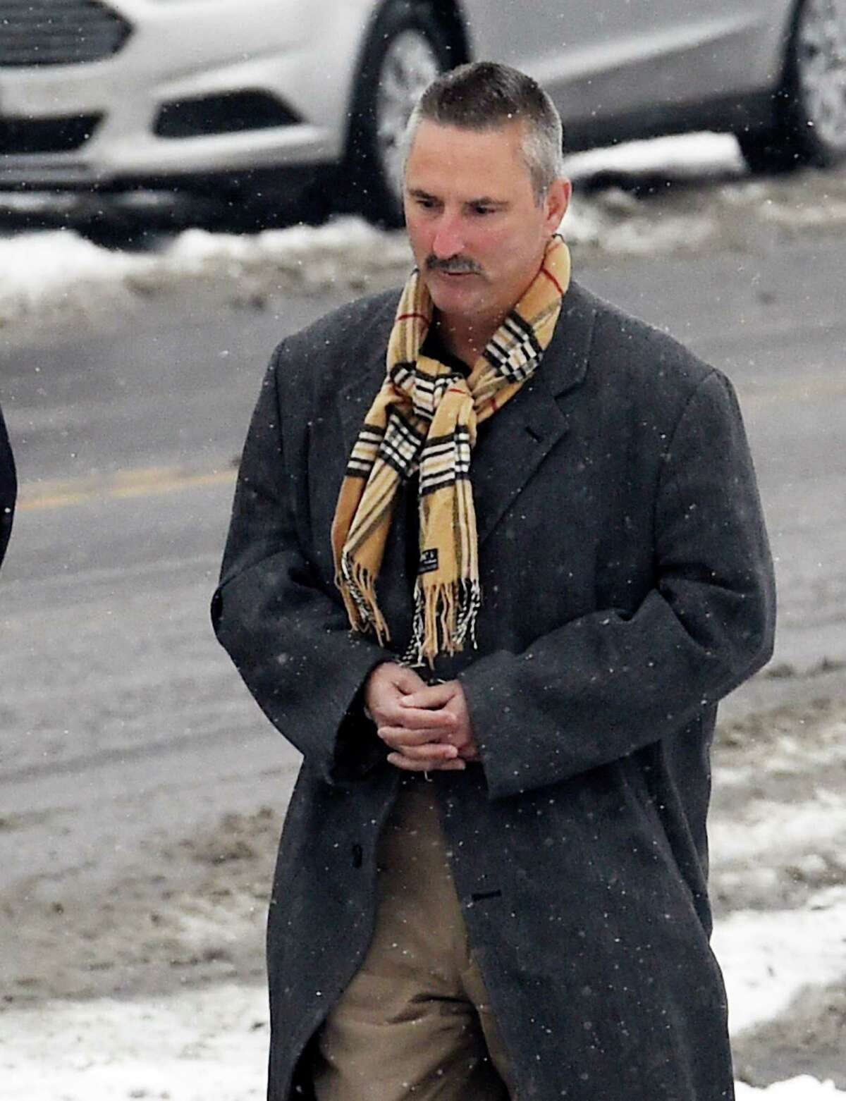 James A. Ferro, 55, arrives at the Albany City Court Monday afternoon Jan. 12, 2015, in Albany, N.Y. to appear on criminal charges that were brought against the former director of operations for the state Department of Corrections and Community Supervision's inspector general's office by the state Inspector General's office. (Skip Dickstein/Times Union)