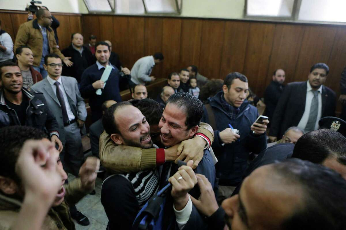 Relatives of 26 men who were arrested in a televised raid last month by police looking for gays at a Cairo public bathhouse celebrate after an Egyptian court acquitted them Monday in Cairo. The trial, which had caused an uproar among activists and rights groups, captured public attention after a pro-government TV network aired scenes of half-naked men being pulled from the bathhouse by police.