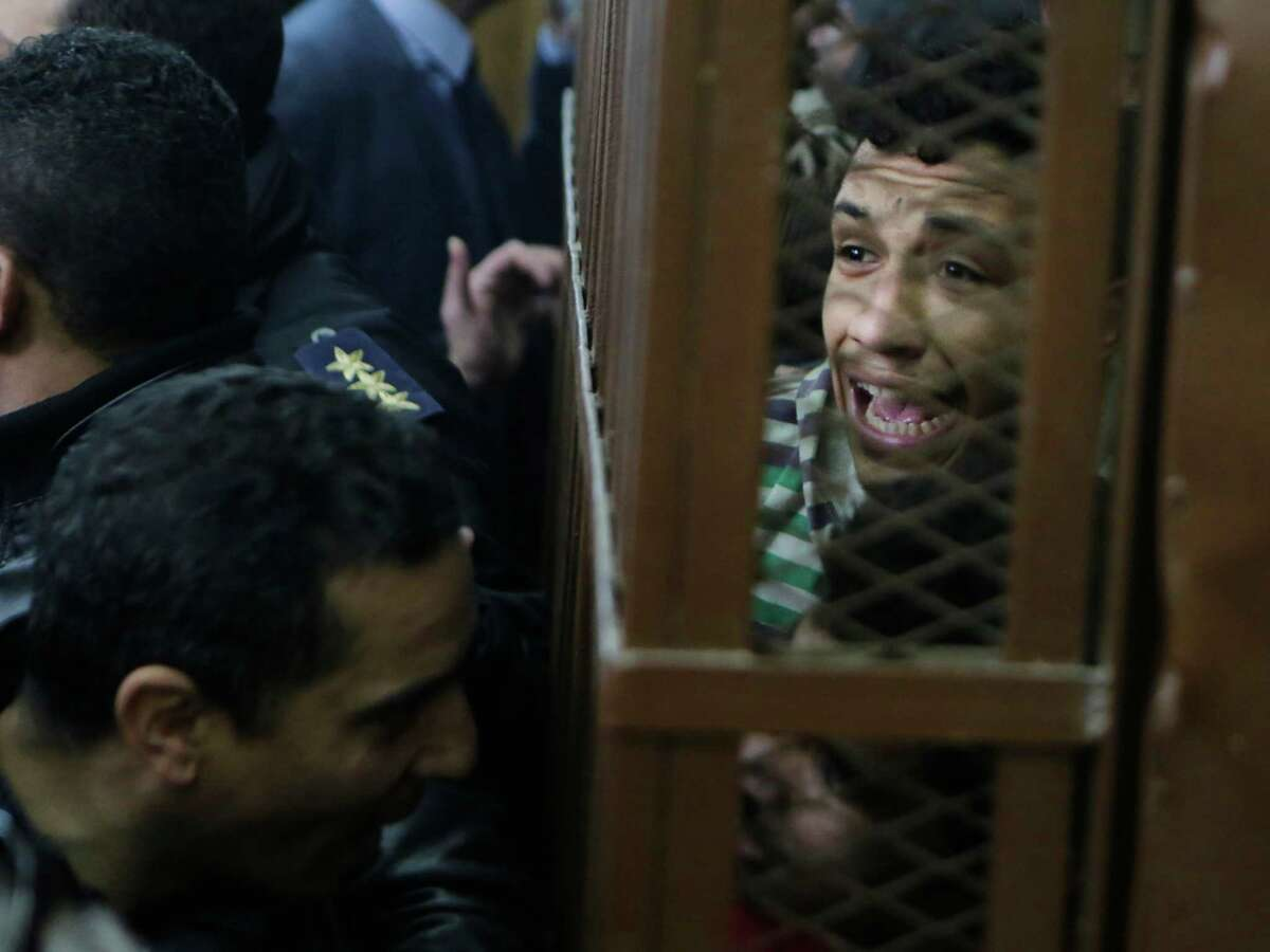 Men who were arrested in a televised raid last month by police looking for gays at a Cairo public bathhouse react after an Egyptian court acquitted them.