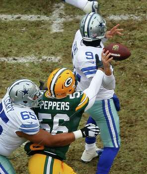 Green Bay Packers outside linebacker Julius Peppers (56) forces Dallas Cowboys quarterback Tony Romo (9) to fumble the ball during the first quarter. Photo: Tom Fox /McClatchy-Tribune News Service / Dallas Morning News
