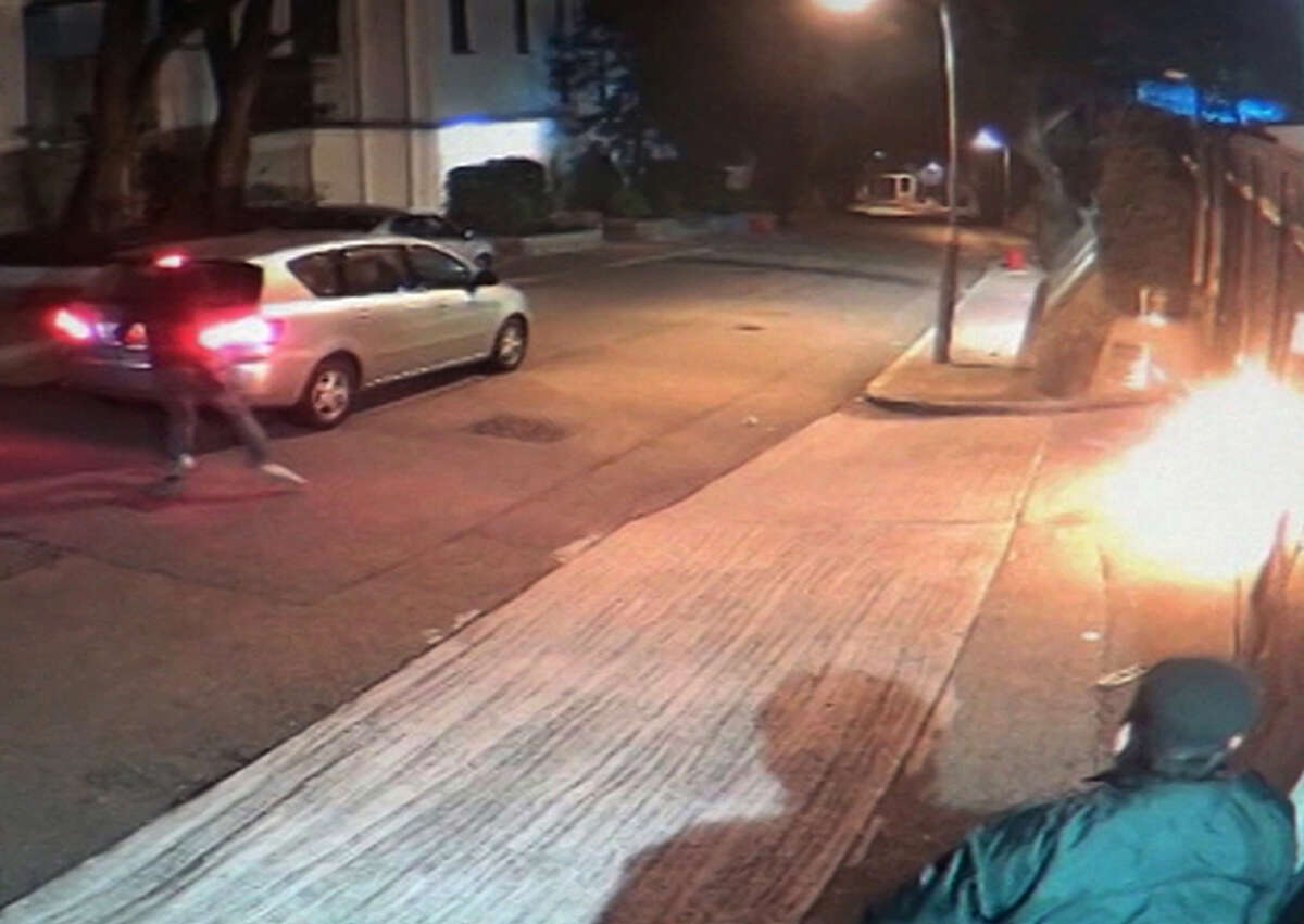 An image taken from surveillance video shows someone throwing a Molotov cocktail toward Jimmy Lai's home.