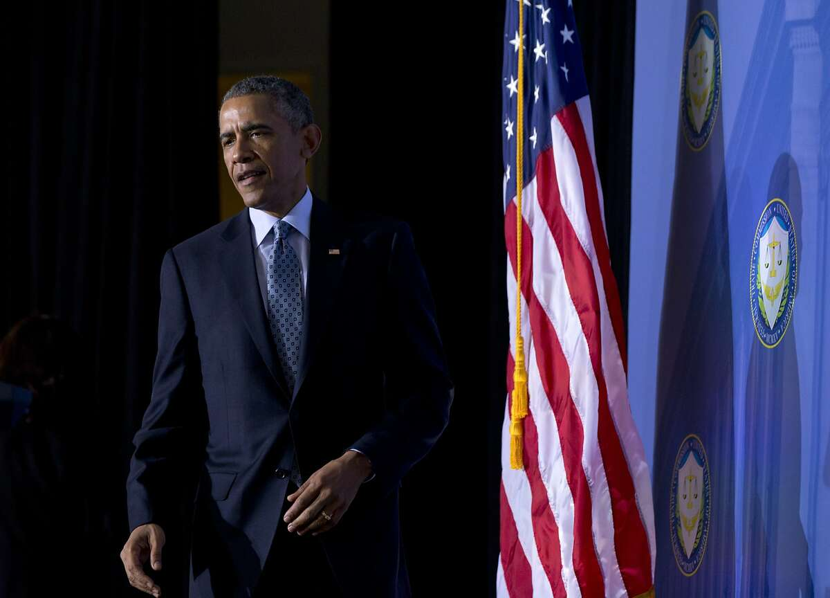 President Barack Obama arrives to speak at the Federal Trade Commission (FTC) offices at the Constitution Center in Washington, Monday, Jan. 12, 2015, about his plan to improve confidence in technology by tackling identify theft and improving consumer and student privacy. The president wants Congress to pass legislation requiring companies to inform customers within 30 days if their data has been hacked, a move that follows high-profile breaches at retailers including Target, Home Depot and Neiman Marcus. (AP Photo/Carolyn Kaster)