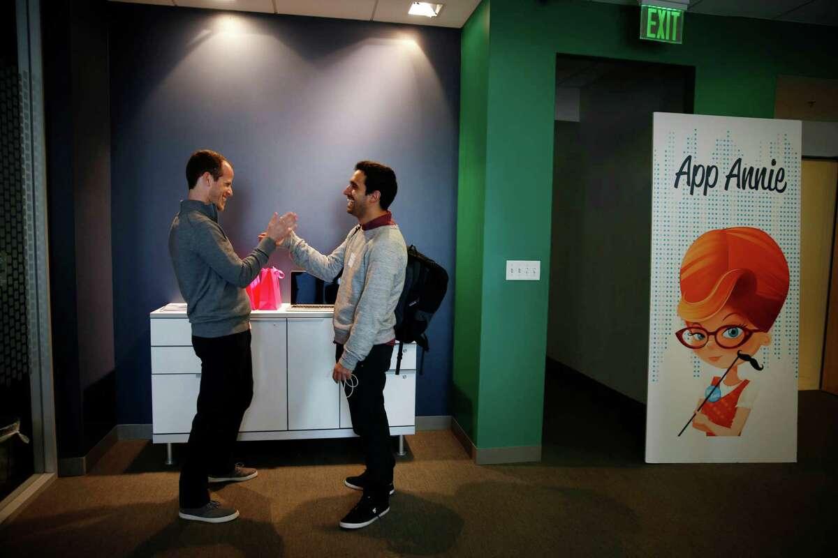 Noam Haberfeld (left), App Annie's senior sales operations manager, shares a laugh with student Daniel Glogowski.