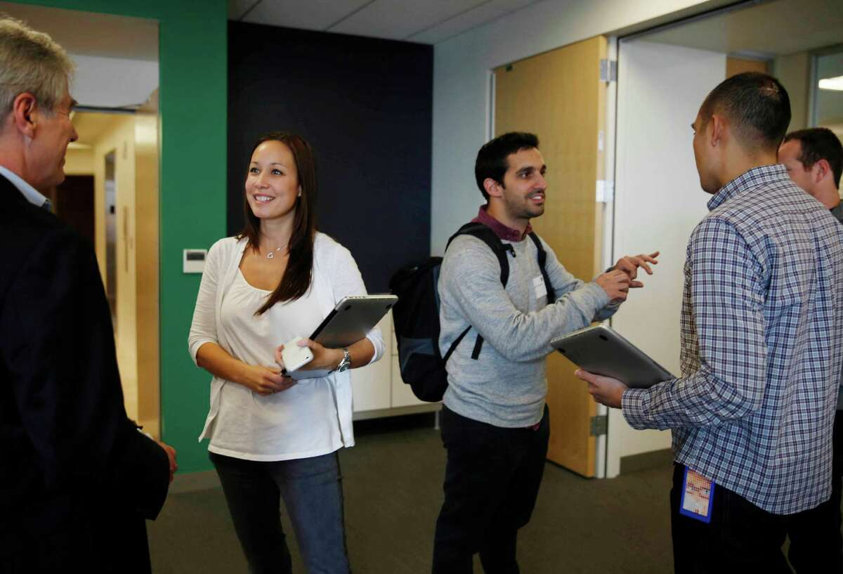 Jackie Hydock, (second from left) director of App Annie's global recruiting, talks with an MIT student as the potential MBAs visit the S.F. startup.