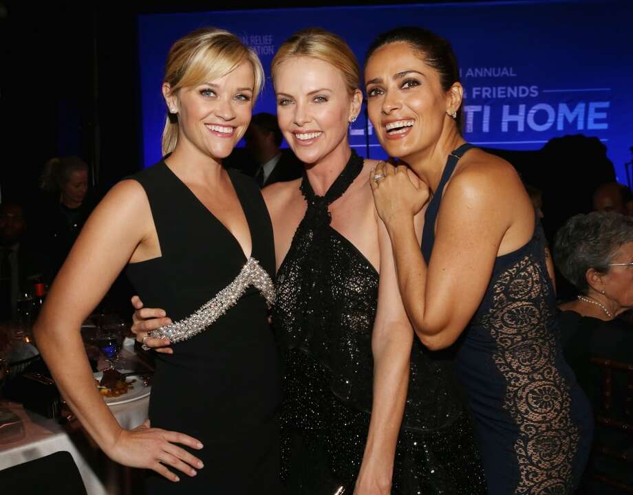 (L-R) Reese Witherspoon, Charlize Theron and Salma Hayek attend the 4th Annual Sean Penn & Friends HELP HAITI HOME Gala Benefiting J/P Haitian Relief Organization on January 10, 2015 in Los Angeles, California. (Photo by Christopher Polk/Getty Images for J/P Haitian Relief Organization)