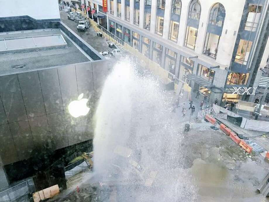 A water main break caused a geyser in front of the Apple Storeat Ellis & Stockton streets in San Francisco on Monday, January 12, 2015. Photo: Amanda Hoac, @its__amandaaa