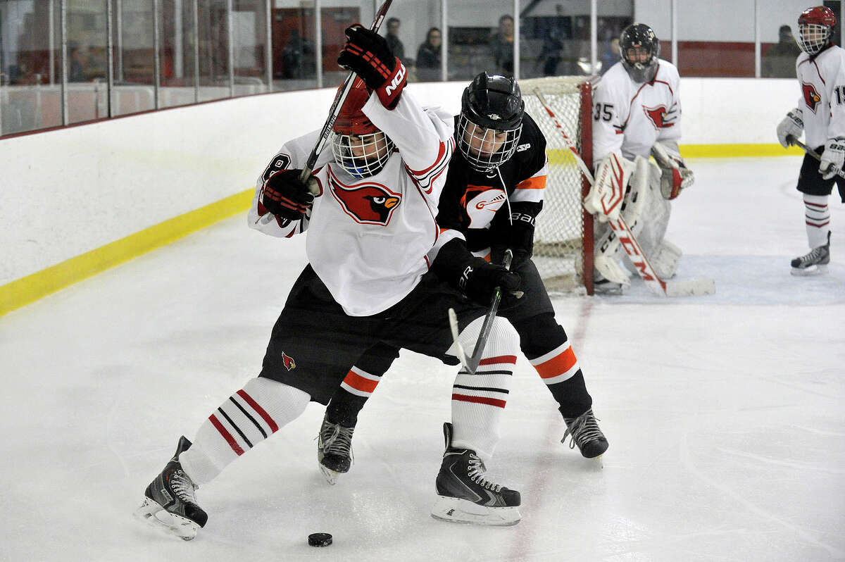 Greenwich's Colin Kelly and Stamford's Andrew Kydes battle for the puck during their hockey game at Dorothy Hamill Skating Rink in Greenwich, Conn., on Monday, Jan. 12, 2015. Greenwich won, 8-1.