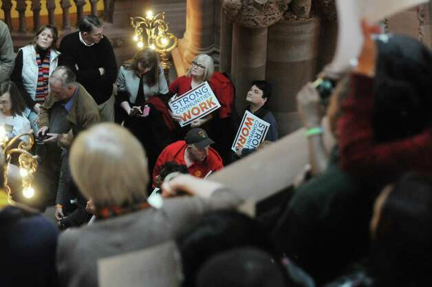 People gather on the Million Dollar Staircase inside the Capitol for an education rally on Monday, Jan. 12, 2015, in Albany, N.Y.  The rally was organized by The Alliance for Quality Education, Citizen Action of New York, Make the Road New York, New York Communities for Change, New York State NAACP, New York State United Teachers, Strong Economy for All Coalition, United Federation of Teachers, and the Working Families Party.  Rally attendees called on the Governor and legislators to address educational inequality and attacks on public education.   (Paul Buckowski / Times Union) Photo: Paul Buckowski / 00030137A
