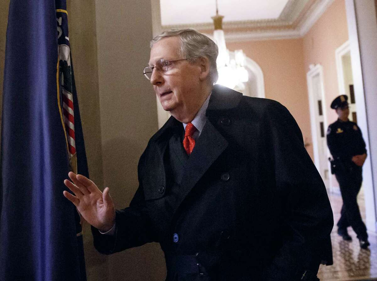 Senate Majority Leader Mitch McConnell, R-Ky., arrives for work at the Capitol as the Republican-controlled Senate is moving ahead on a bill to construct the Keystone XL pipeline despite President Barack Obama's veto threat, in Washington, Monday, Jan. 12, 2015. The House approved the bill last Friday. (AP Photo/J. Scott Applewhite)