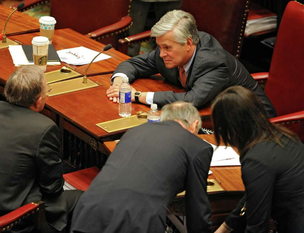 Senate majority leader Dean Skelos, right, confers with Sen. John DeFrancisco, R-Syracuse, left, during session Monday afternoon, Jan. 12, 2015, at the Capitol in Albany, N.Y. (Lori Van Buren / Times Union)