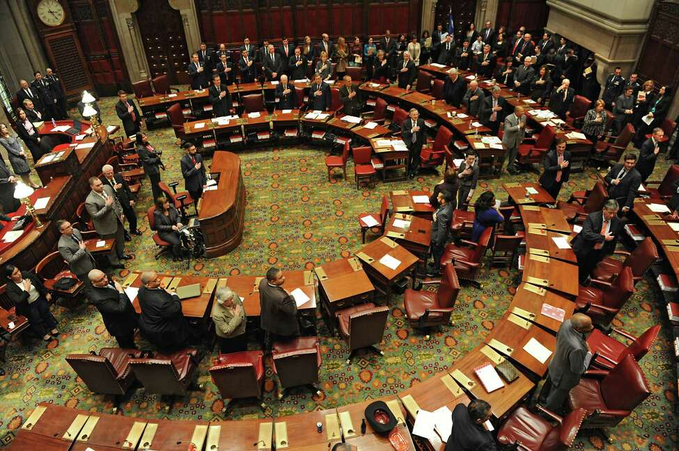 Members of the New York State Senate stand during the beginning of session Monday afternoon, Jan. 12, 2015, at the Capitol in Albany, N.Y. (Lori Van Buren / Times Union)