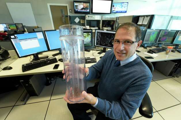 Stephen DiRienzo shows a hydrometer which is may be used by weather spotters for National Weather Service  Jan. 8, 2015 in Albany, N.Y.  (Skip Dickstein/Times Union) Photo: SKIP DICKSTEIN / 00030094A