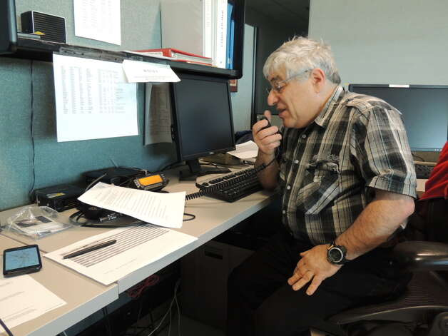 Bruce Goldstein, 68, of New Salem, a SKYWATCH weather spotter for the National Weather Service operates a ham radio at the National Weather Service station in Albany. Photo provided by Bruce Goldstein