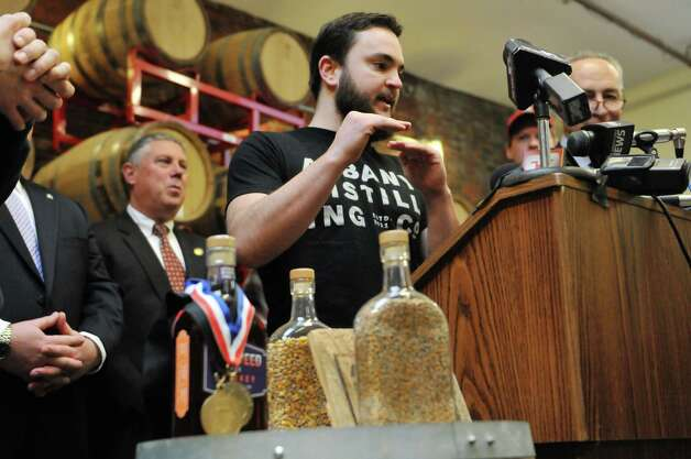 Albany Distilling Company owner John Curtin talks about his business during a press conference at the Albany Distilling Company on Monday, Jan. 12, 2015, in Albany, N.Y.  Senator Charles Schumer held a press event at the distillery to push for crop insurance for New York State malt barley farmers.  (Paul Buckowski / Times Union) Photo: Paul Buckowski / 00030154A