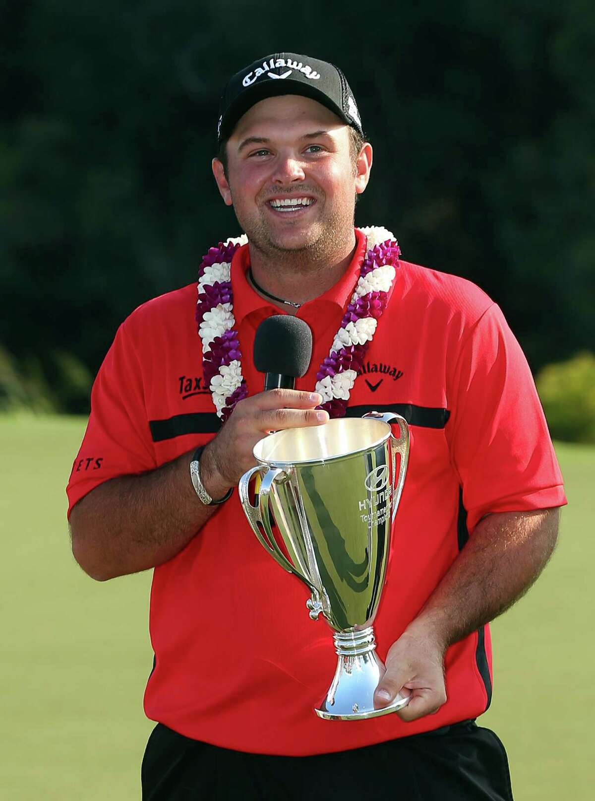 LAHAI NA, HI - JANUARY 12: Patrick Reed poses with the winner's trophy after winning during the final round of the Hyundai Tournament of Champions at Plantation Course at Kapalua Golf Club on January 12, 2015 in Lahaina, Hawaii. (Photo by Mike Ehrmann/Getty Images)