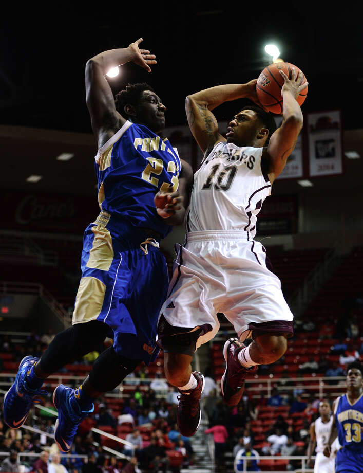 Ozen's Jordan Hunter, No. 23, goes up to block Central's Dominique Harrison, No. 10, during Monday's game. The Central Jaguars and Ozen Panthers played at the Lamar University's Montagne Center on Monday night.  Photo taken Monday 1/12/15  Jake Daniels/The Enterprise Photo: Jake Daniels / ©2014 The Beaumont Enterprise/Jake Daniels