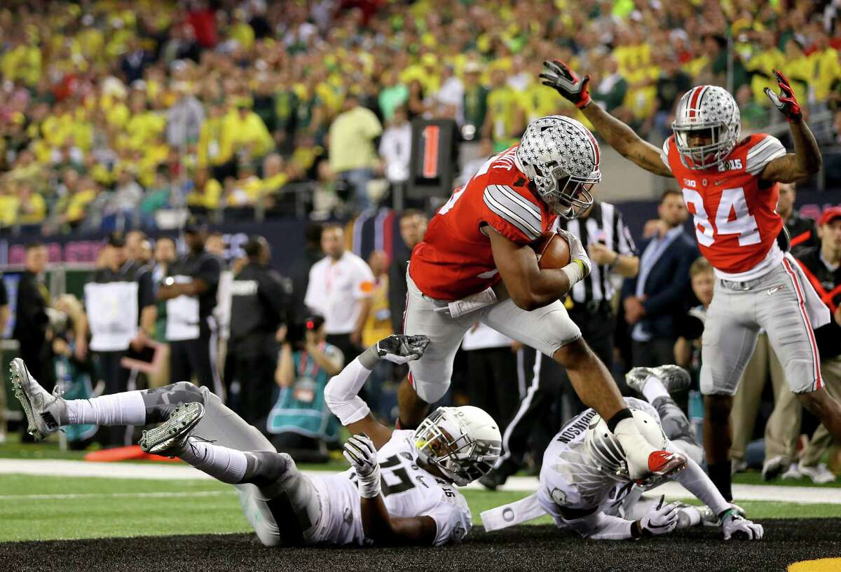 Ohio State's Ezekiel Elliott barrels into the end zone on a 9-yard run in the third quarter for the second of his four touchdowns.