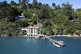 The three-story Italianate estate designed by renowned architect Andrew Skurman features 130 feet of coastal property and a 100-foot pier extending into the bay.