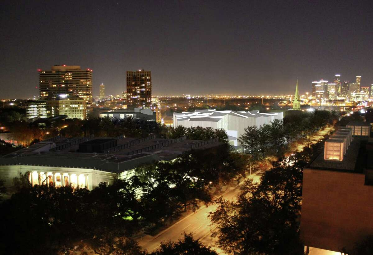 An aerial night view of the planned Fayez S. Sarofim Campus, with the Kinder Foundation Building glowing alongside Main Street.