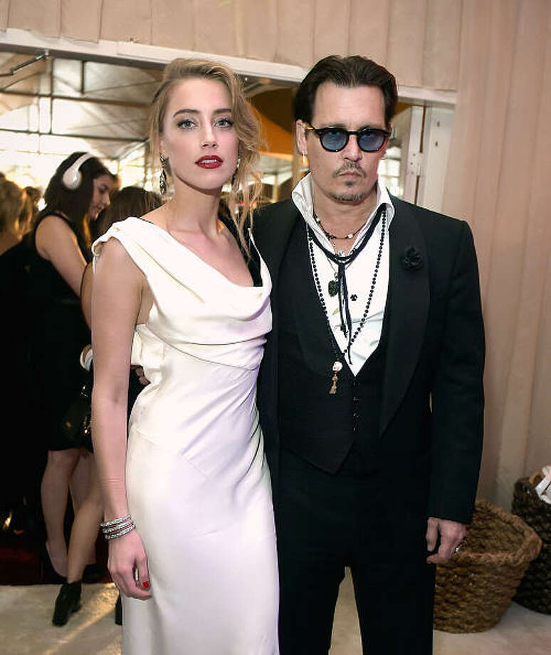 Amber Heard, 28, and Johnny Depp, 51. Photo: Jason Kempin, Getty Images / 2015 Getty Images